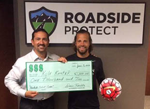 Kyle_Knotek_Receives_Roadside_Cares_Award